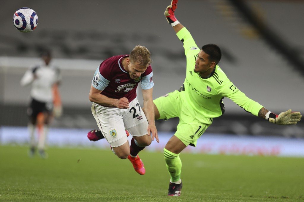 Burnley's Matej Vydra is challenged by Fulham's goalkeeper Alphonse Areola during the English Premier League soccer match between Fulham and Burnley a...