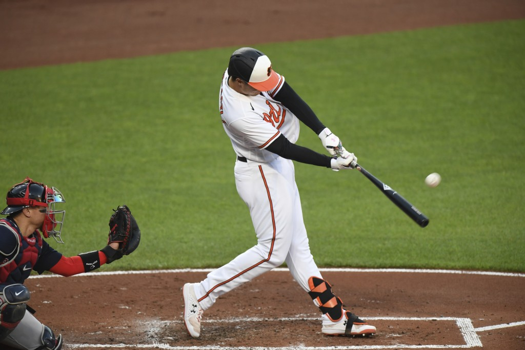Baltimore Orioles Ryan Mountcastle hits a solo home run against the Boston Red Sox during the first inning of baseball game Monday, May 10, 2021, in B...