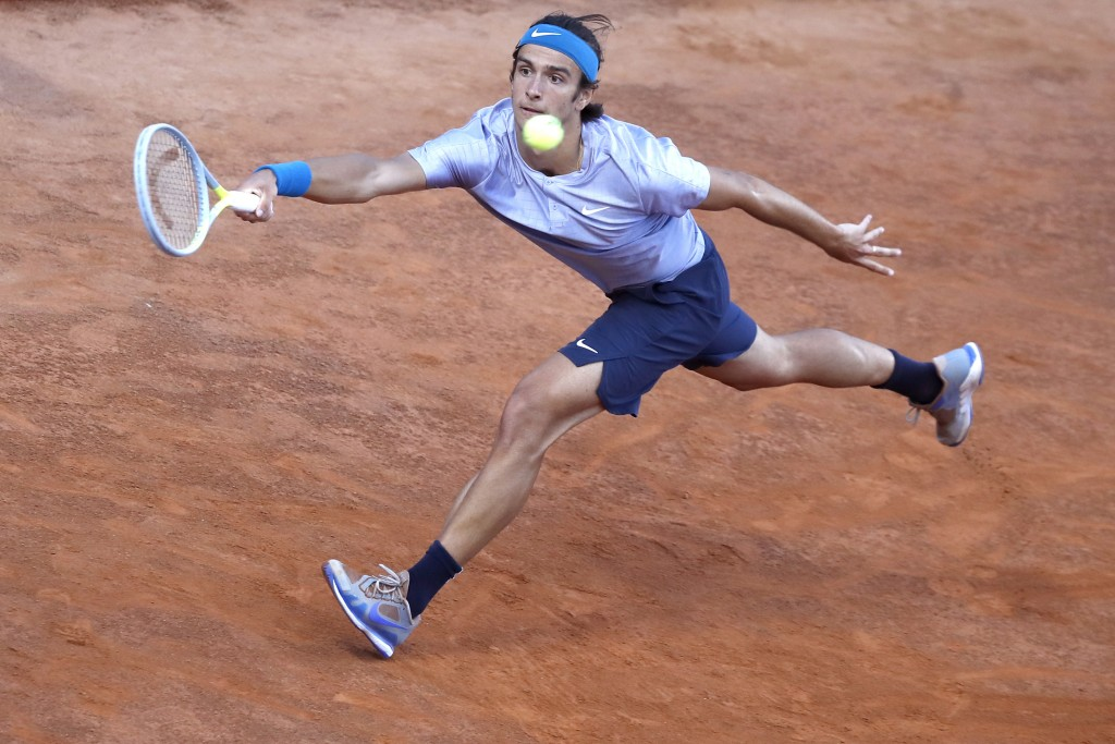 Lorenzo Musetti of Italy returns the ball to Hubert Hurkacz of Poland during their match at the Italian Open tennis tournament, in Rome, Monday, May 1...