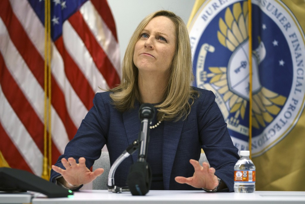FILE - In this Dec. 11, 2018, file photo, Consumer Financial Protection Bureau Director Kathy Kraninger pauses as she speaks to media at the CFPB offi...
