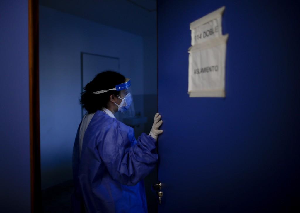 Dr. Veronica Verdino enters in a room to check on COVID-19 patients at Llavallol Dr. Norberto Raúl Piacentini Hospital in Lomas de Zamora, Argentina, ...