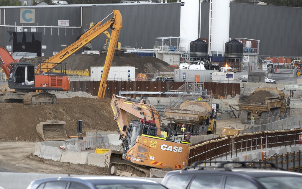 Heavy machinery work at a major road project in Sydney, Australia, Tuesday, May 11, 2021. The Australian government will release its big-spending econ...