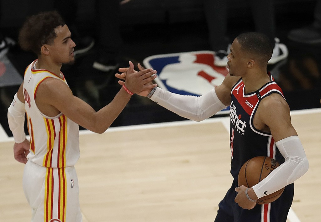 Washington Wizards' Russell Westbrook, right, is congratulated by Atlanta Hawks' Trae Young after an NBA basketball game Monday, May 10, 2021, in Atla...