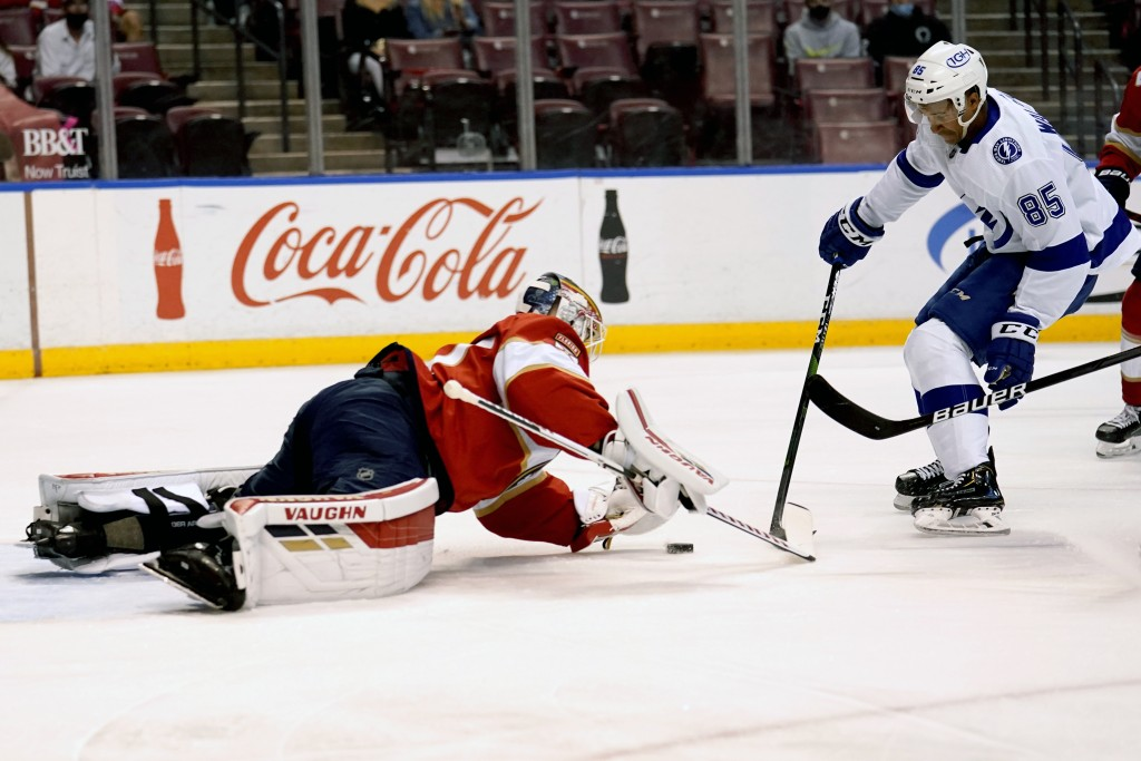 Florida Panthers goaltender Chris Driedger, left, defends the goal against Tampa Bay Lightning's Daniel Walcott (85) during the first period of an NHL...