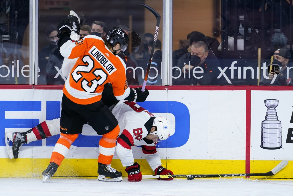 Philadelphia Flyers' Oskar Lindblom (23) and New Jersey Devils' Kevin Bahl (88) collide during the second period of an NHL hockey game, Monday, May 10...