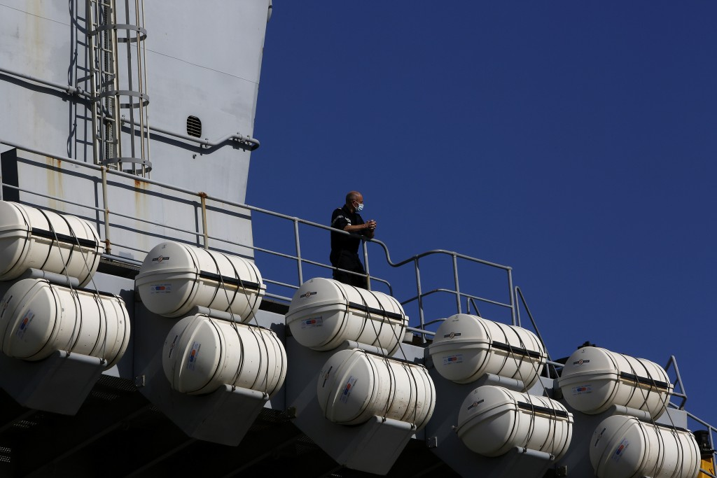 A French crew member stands at France's nuclear-powered aircraft carrier Charles de Gaulle in Limassol port, Cyprus, Monday, May 10, 2021.  With the T...