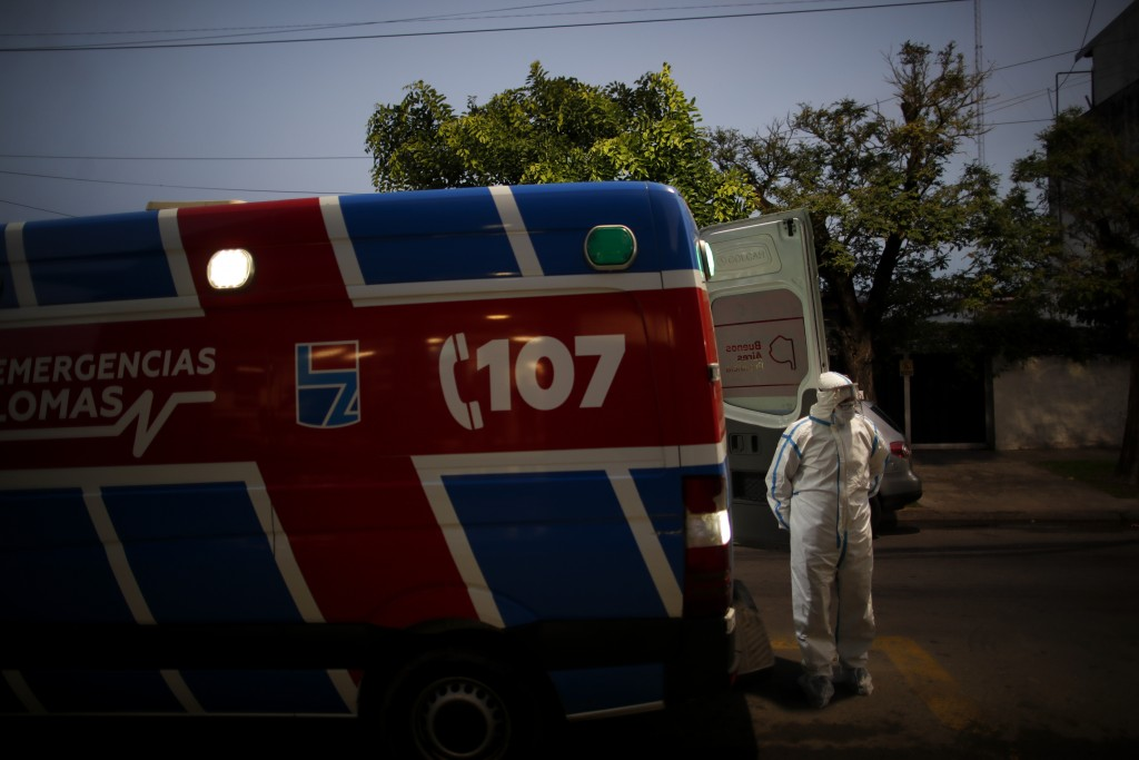 A heath worker waits to admit a COVID-19 patient to Llavallol Dr. Norberto Raúl Piacentini Hospital in Lomas de Zamora, on the outskirts of Buenos Air...