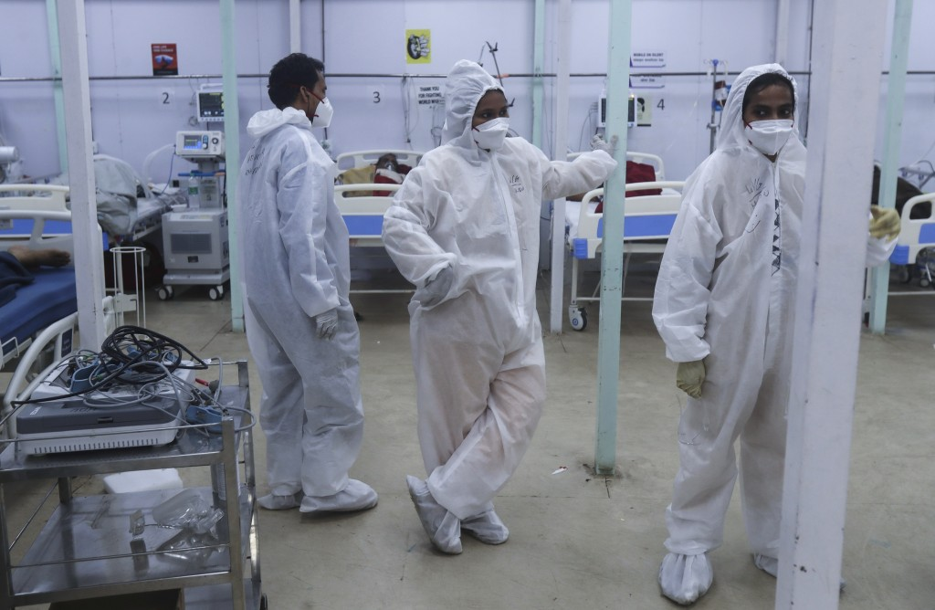 Health workers keep a watch on patients in a ward at the BKC jumbo field hospital, one of the largest COVID-19 facilities in Mumbai, India, Friday, Ma...