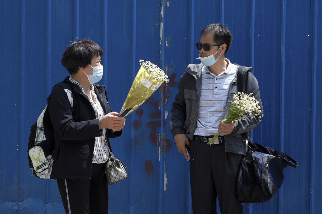 Wei Xiuwen, mother of Chen Mei, chats with Cai Jianli, father of Cai Wei outside a courthouse after attending their children's court cases in Beijing,...