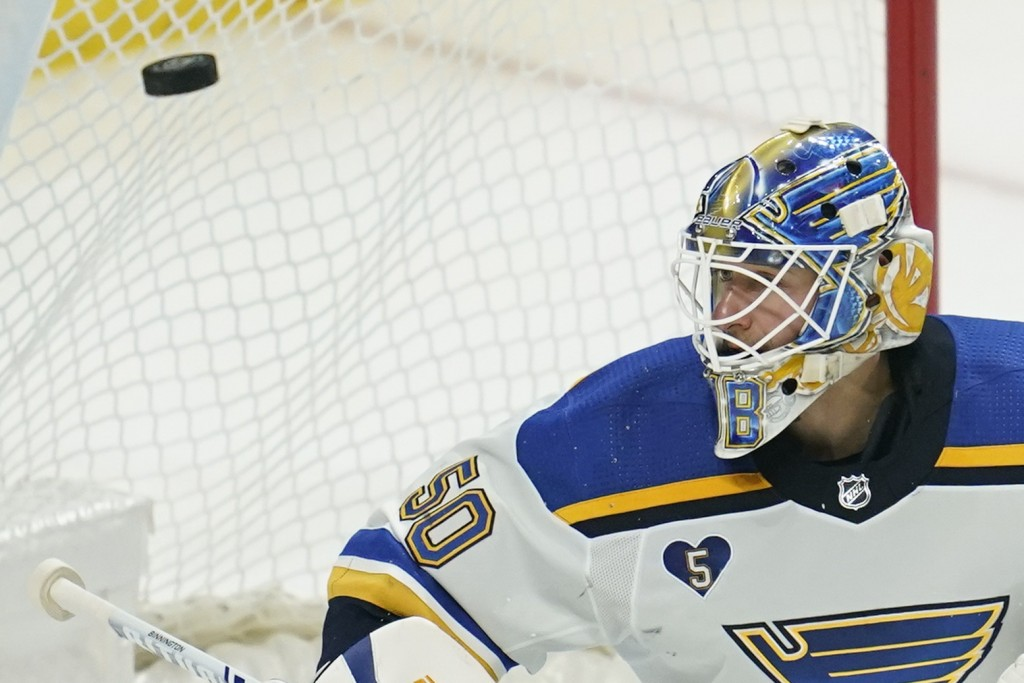 St. Louis Blues goaltender Jordan Binnington (50) watches as a puck flies away from the goal during the third period of a hockey game against the Los ...