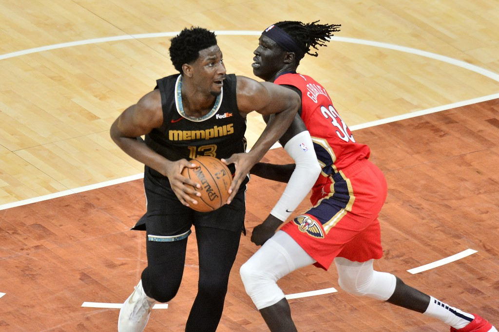Memphis Grizzlies forward Jaren Jackson Jr., left, handles the ball against New Orleans Pelicans forward Wenyen Gabriel, right, in the first half of a...