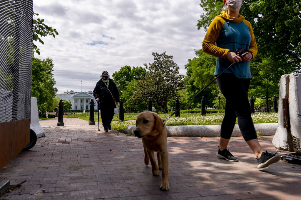 Lafayette Park, across the street from the White House, reopens in a limited capacity in Washington, Monday, May 10, 2021. Fencing remains in place ar...