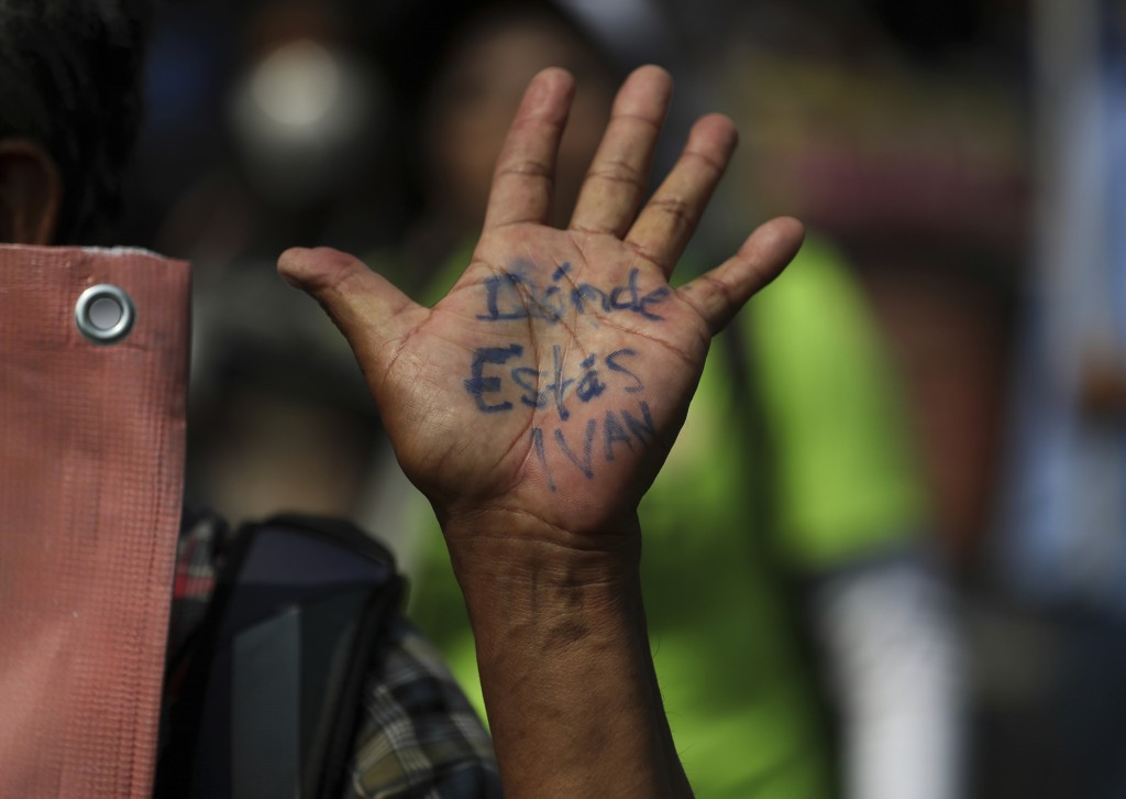 """A person's his hand reads in Spanish """"Where are you Ivan?"""" during a march in remembrance of those who have disappeared, on Mother's Day in Mexico City..."""