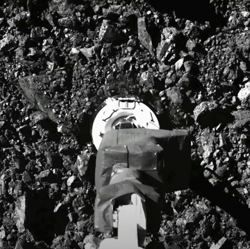 FILE - In this image taken from video released by NASA, the Osiris-Rex spacecraft touches the surface of asteroid Bennu on Tuesday, Oct. 20, 2020. (NA...