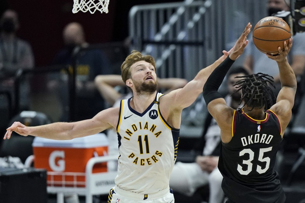 Indiana Pacers' Domantas Sabonis (11) blocks a shot by Cleveland Cavaliers' Isaac Okoro (35) in the second half of an NBA basketball game, Monday, May...