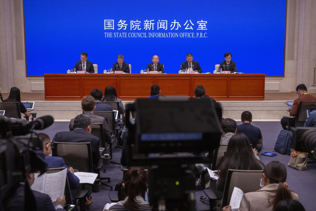 Ning Jizhe, center, commissioner of China's National Bureau of Statistics, speaks during a press conference at the State Council Information Office in...