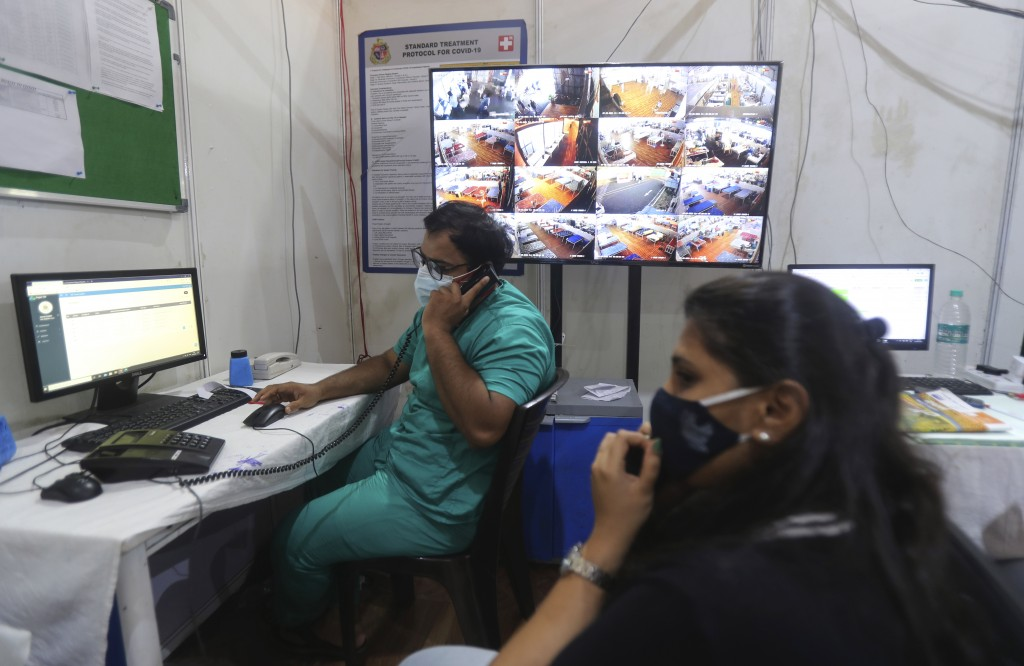 Senior consultants monitor and evaluate each patient's medical condition remotely in the war room of BKC jumbo field hospital, one of the largest COVI...