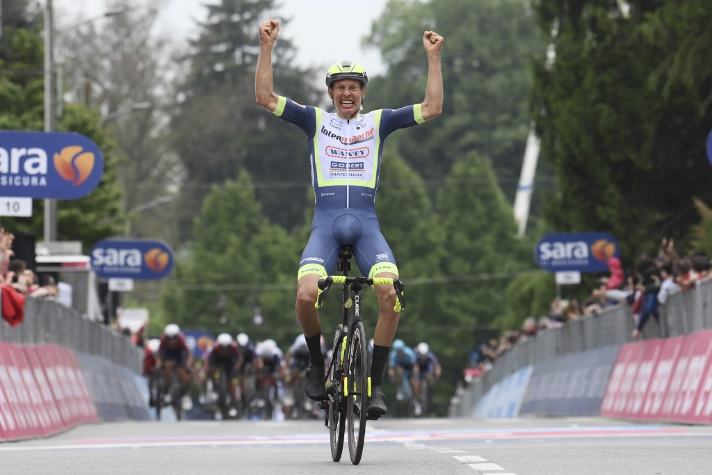 Dutch rider Taco van der Hoorn celebrates winning the third stage of the Giro d'Italia, tour of Italy cycling race from Biella to Canale, Italy, Monda...