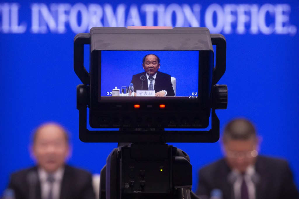A video screen shows Ning Jizhe, commissioner of China's National Bureau of Statistics, as he speaks during a press conference at the State Council In...