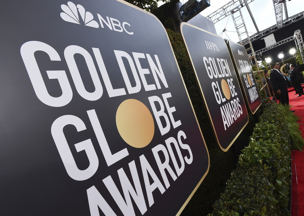 FILE - Signage promoting the 77th annual Golden Globe Awards and NBC appears in Beverly Hills, Calif. on Jan. 5, 2020.  NBC said Monday that will not ...