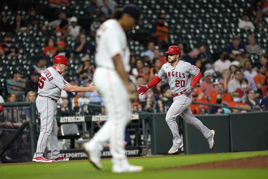 Los Angeles Angels' Jared Walsh (20) celebrates with third base coach Brian Butterfield (55) after hitting a home run off Houston Astros starting pitc...