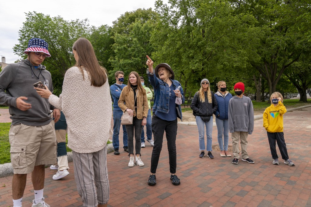 Charity Struthers with Signature Tours brings a group of students into Lafayette Park, across the street from the White House, as it reopens in a limi...