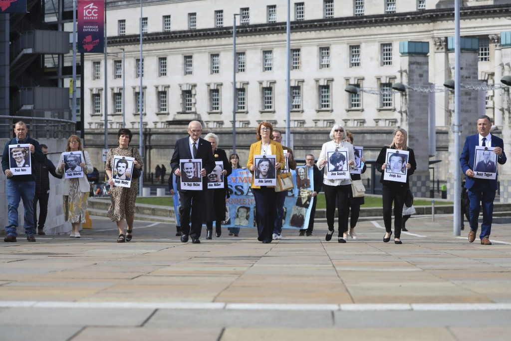 Family members arrive for the inquest into the Ballymurphy shooting, in Belfast, Northern Ireland, Tuesday May 11, 2021. The findings of the inquest i...