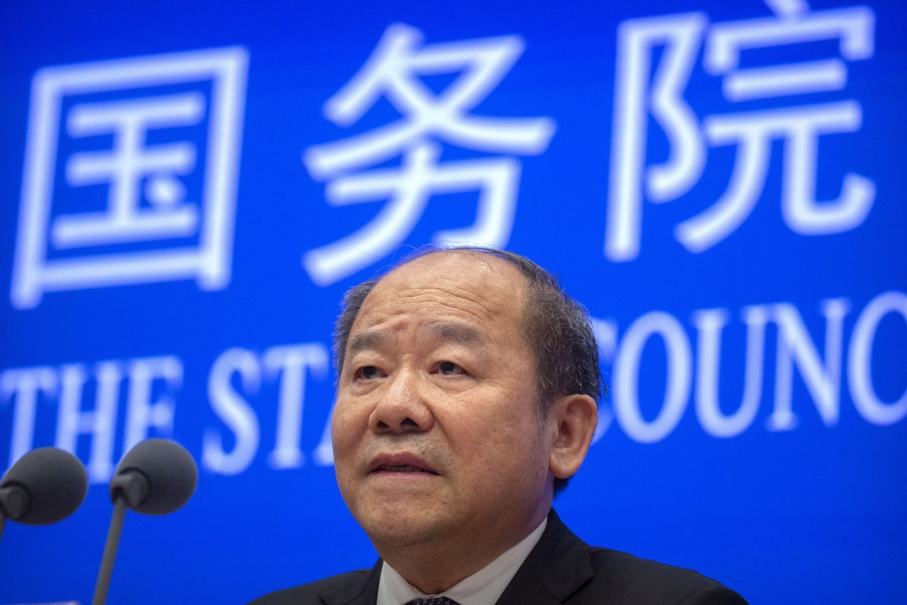 Ning Jizhe, commissioner of China's National Bureau of Statistics, speaks during a press conference at the State Council Information Office in Beijing...