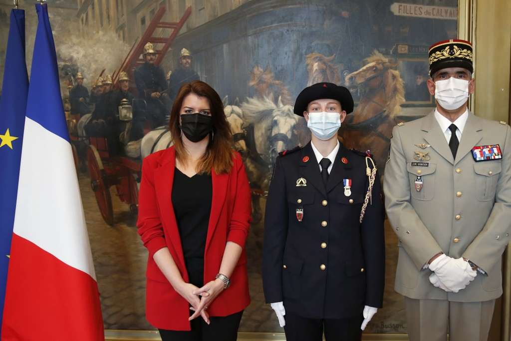 France's minister for citizenship issues, Marlene Schiappa, right, and General commander of the Paris Firefighters Brigade Jean-Marie Gontier, right, ...