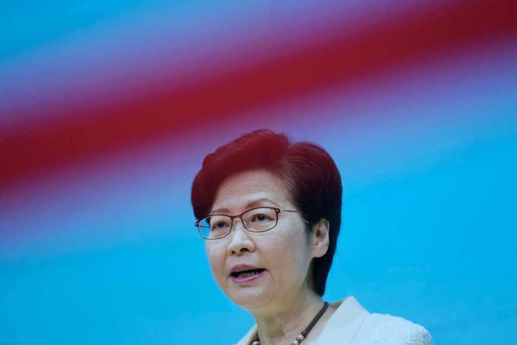 Hong Kong Chief Executive Carrie Lam speaks during a news conference in Hong Kong, Tuesday, May 11, 2021. Lam announced Hong Kong officials have dropp...