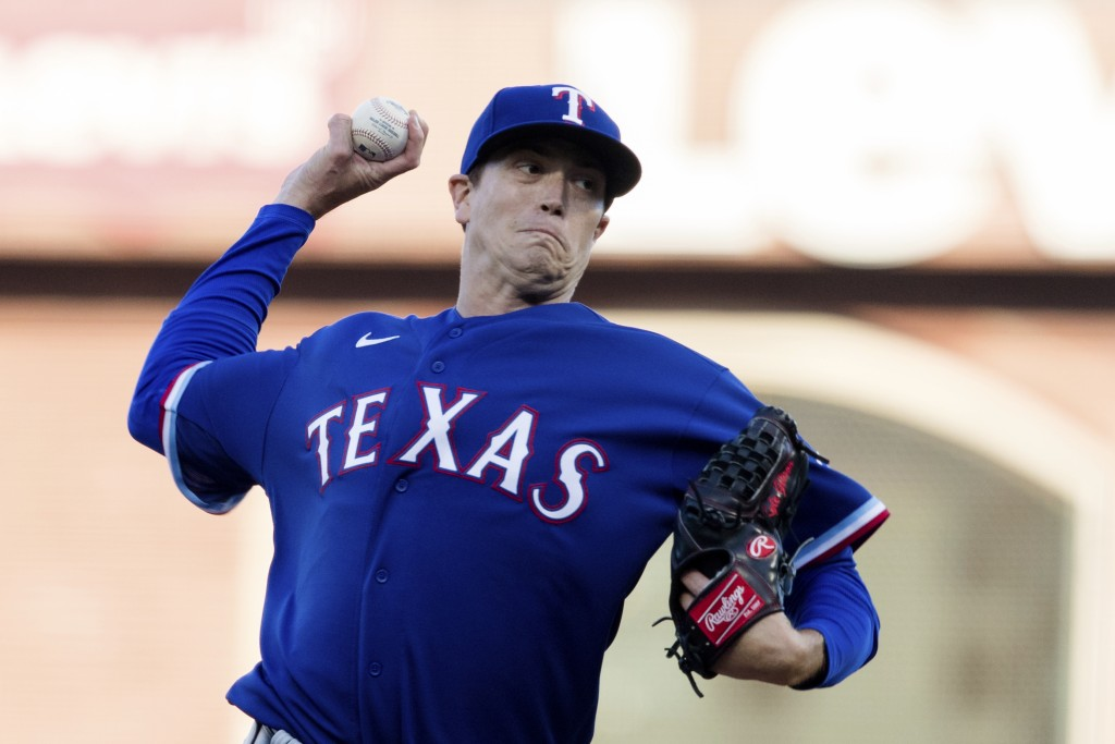 Texas Rangers starting pitcher Kyle Gibson (44) throws against the San Francisco Giants during the first inning of a baseball game in San Francisco, M...