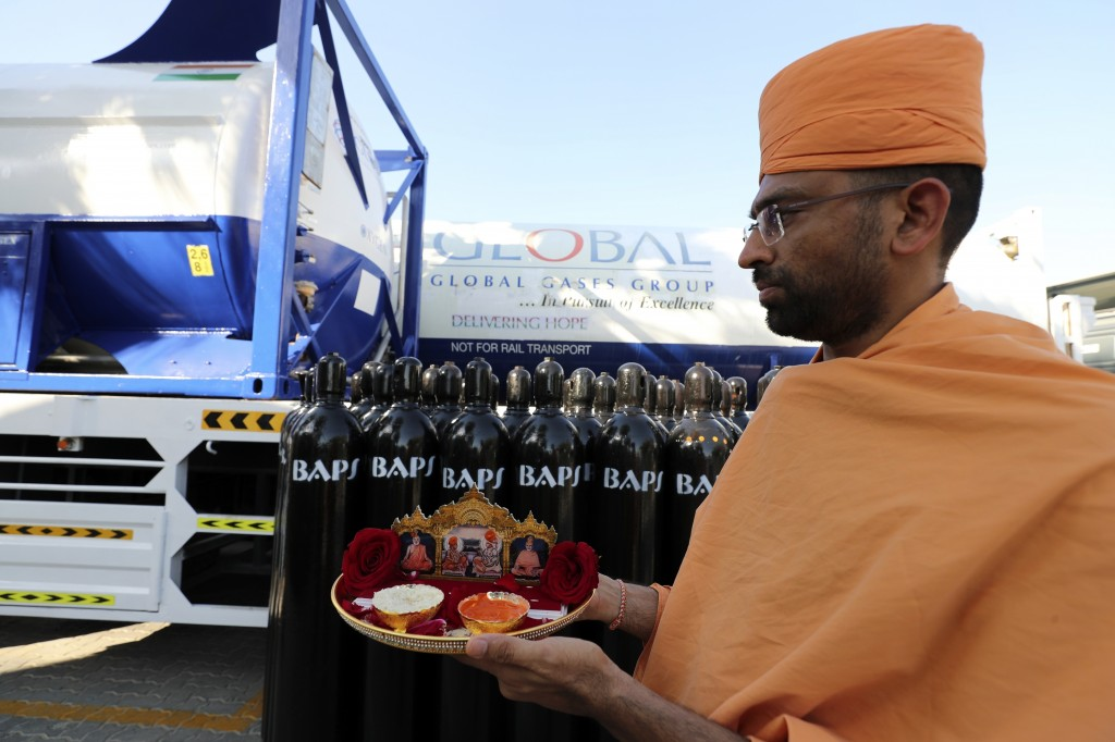 Chairman of BAPS Hindu Mandir, the main Hindu temple in Abu Dhabi, Ashok Kotecha, takes part in a blessing ceremony before shipping oxygen supplies to...