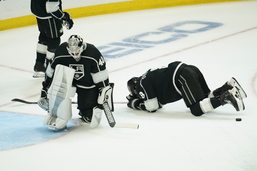 Los Angeles Kings goaltender Calvin Petersen (40) and defenseman Drew Doughty (8) react after the St. Louis Blues scored in overtime Monday, May 10, 2...
