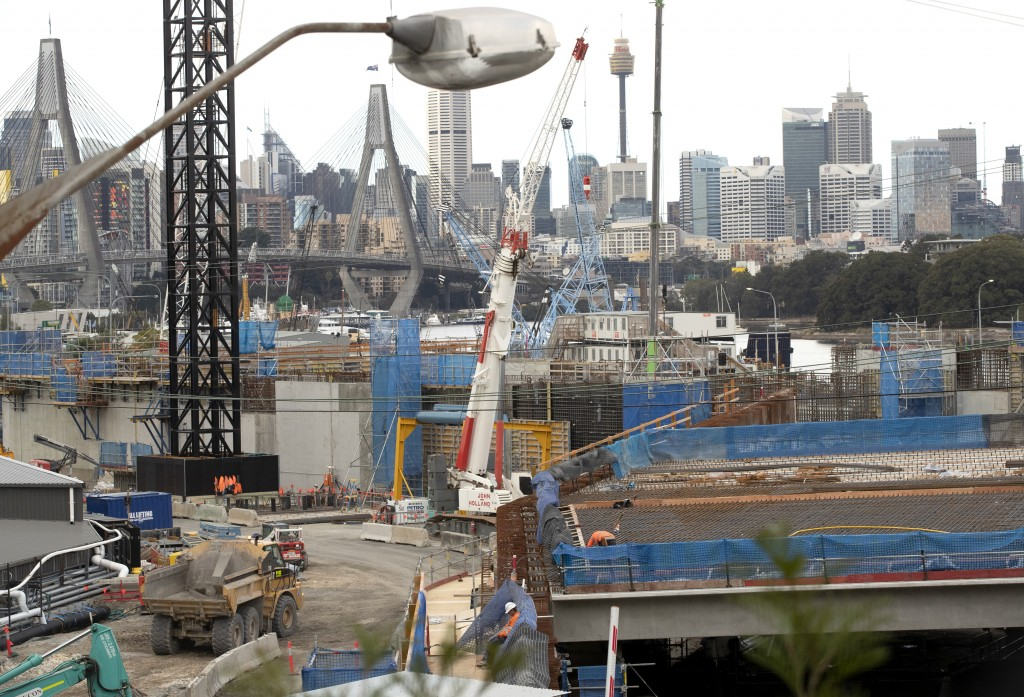 Construction teams work on a major road project in Sydney, Australia, Tuesday, May 11, 2021. The Australian government will release its big-spending e...