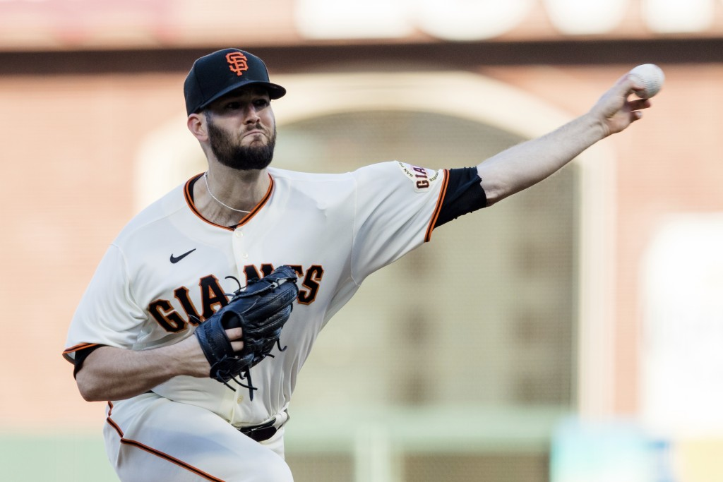 San Francisco Giants starting pitcher Alex Wood throws against the Texas Rangers during the first inning of a baseball game in San Francisco, Monday, ...
