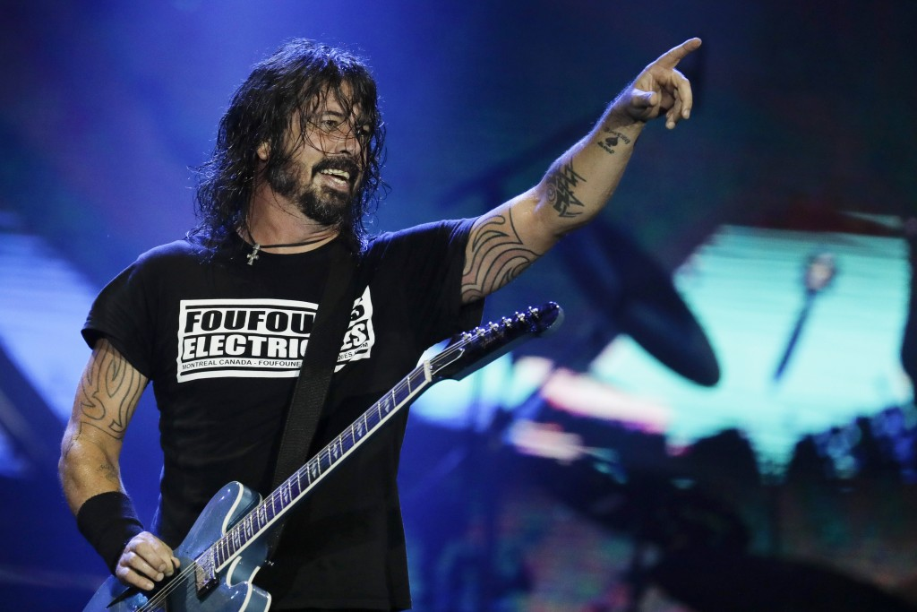 FILE - In this Sept. 29, 2019, file photo, Dave Grohl of the band Foo Fighters performs at the Rock in Rio music festival in Rio de Janeiro, Brazil. T...