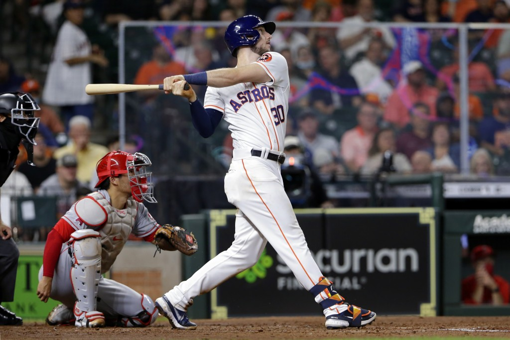 Houston Astros' Kyle Tucker (30) watches his home run in front of Los Angeles Angels catcher Kurt Suzuki, left, during the fifth inning of a baseball ...