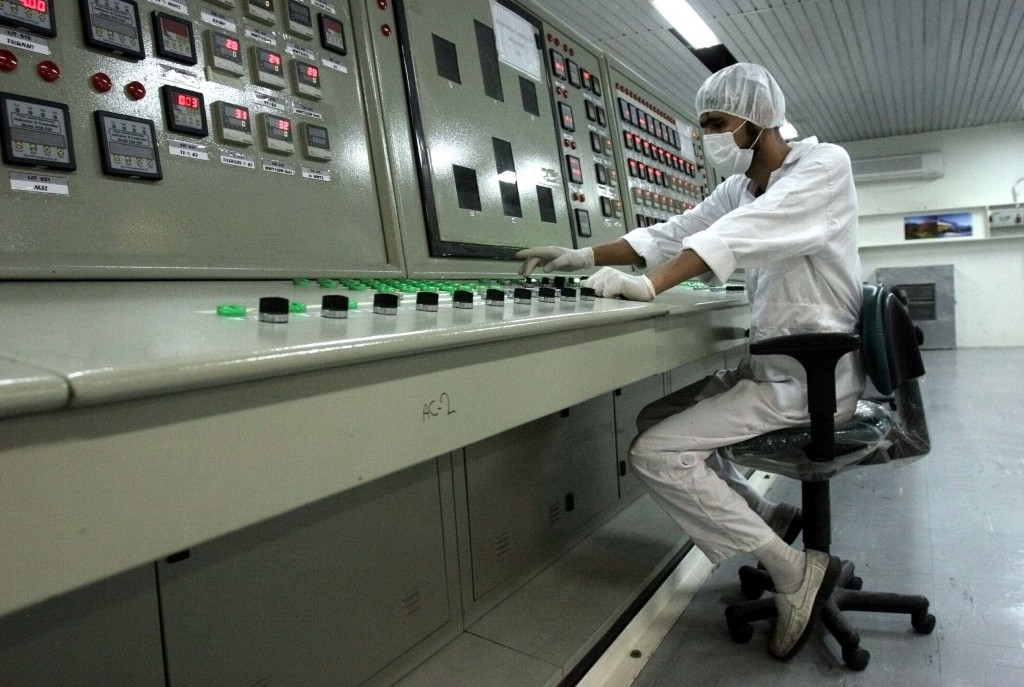 FILE - In this Feb. 3, 2007 file photo, a technician works at the Uranium Conversion Facility just outside the city of Isfahan, Iran, 255 miles (410 k...