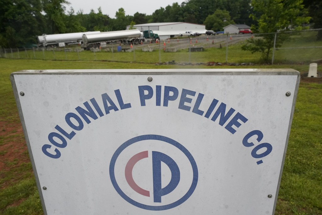 Tanker trucks are parked near the entrance of Colonial Pipeline Company Wednesday, May 12, 2021, in Charlotte, N.C.  Several gas stations in the South...