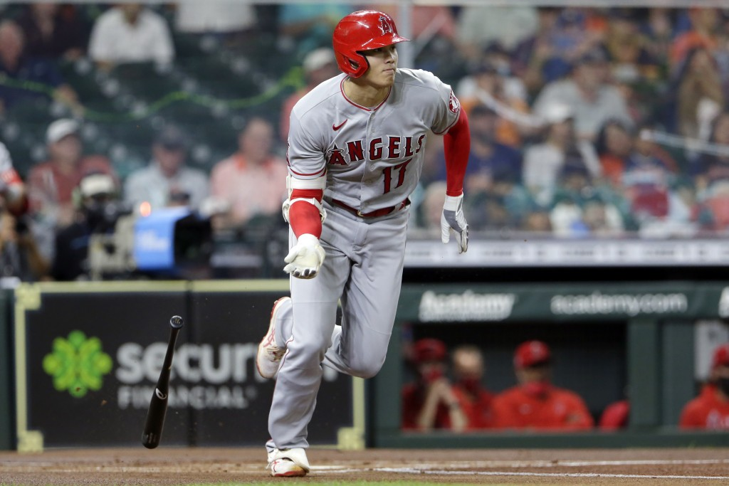Batting second in the line up and also the starting pitcher, Los Angeles Angels Shohei Ohtani (17) flips his bat as he grounds out during the first in...