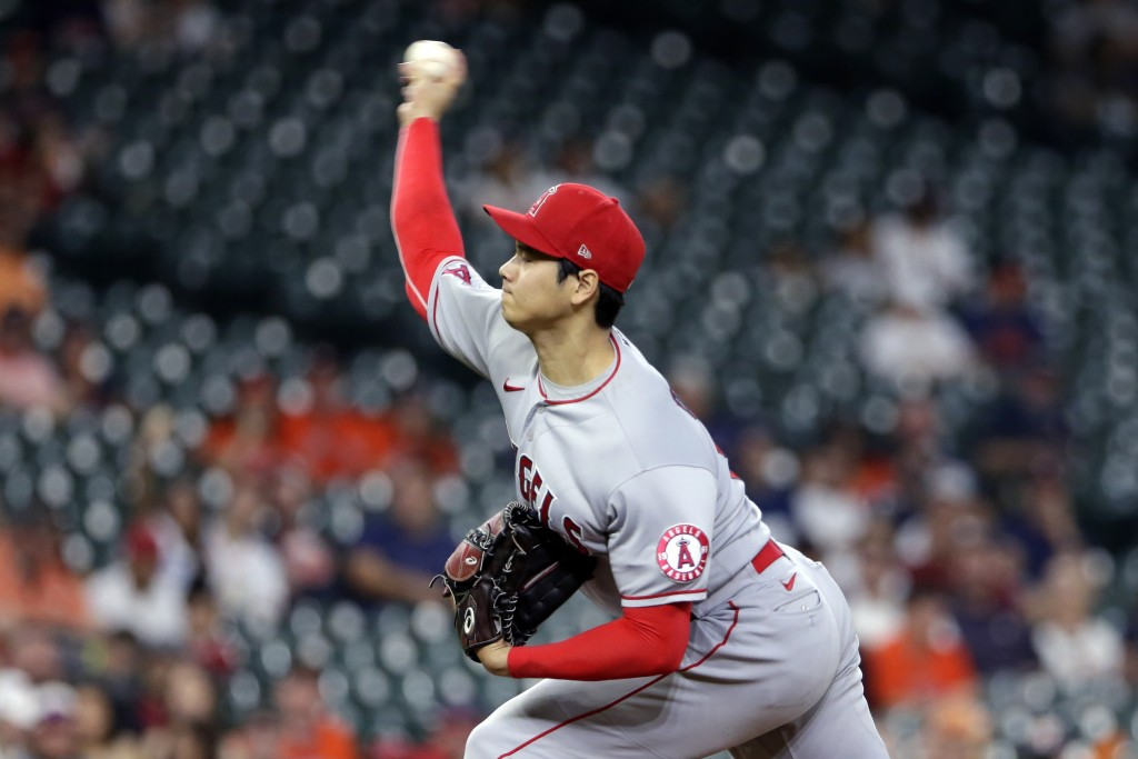 Los Angeles Angels starting pitcher Shohei Ohtani throws against the Houston Astros during the first inning of a baseball game Tuesday, May 11, 2021, ...