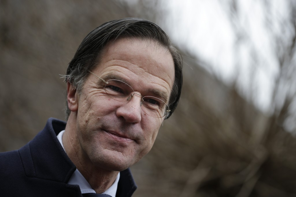 FILE - In this file photo dated Wednesday, March 17, 2021, Dutch caretaker Prime Minster Mark Rutte answers questions after casting his vote in a gene...