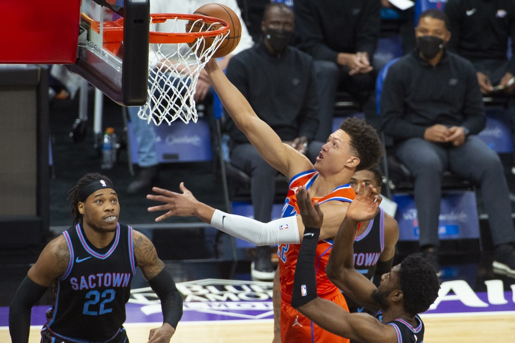 Oklahoma City Thunder center Isaiah Roby (22) drives to the basket against the Sacramento Kings during the first quarter of an NBA basketball game in ...