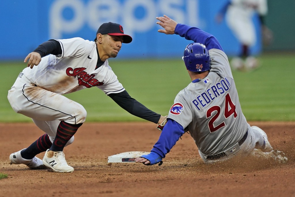 Cleveland Indians' Cesar Hernandez (7) tags out Chicago Cubs' Joc Pederson (24) after Pederson tried to steal to second base in the seventh inning of ...