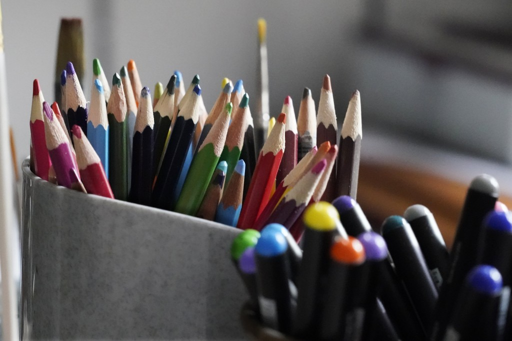 Colored pencils, sharpened and at the ready, rest in a container on the desk of artist Robert Seaman in his room at an assisted living facility Monday...