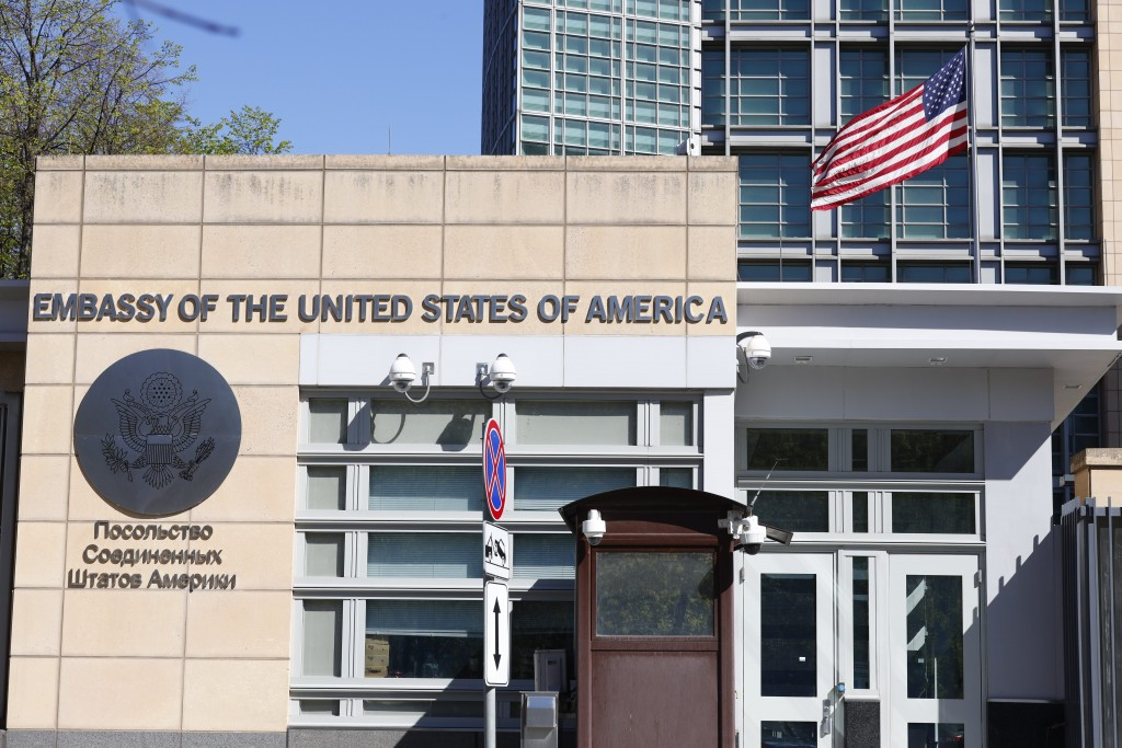 The U.S. Embassy and the National flag are seen in Moscow, Russia, Tuesday, May 11, 2021. Under Kremlin orders, the U.S. Embassy has stopped employing...