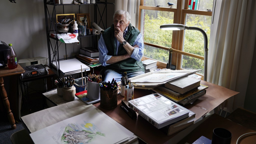 Artist Robert Seaman pauses while sketching in his room at an assisted living facility Monday, May 10, 2021, in Westmoreland, N.H. Seaman, who moved i...