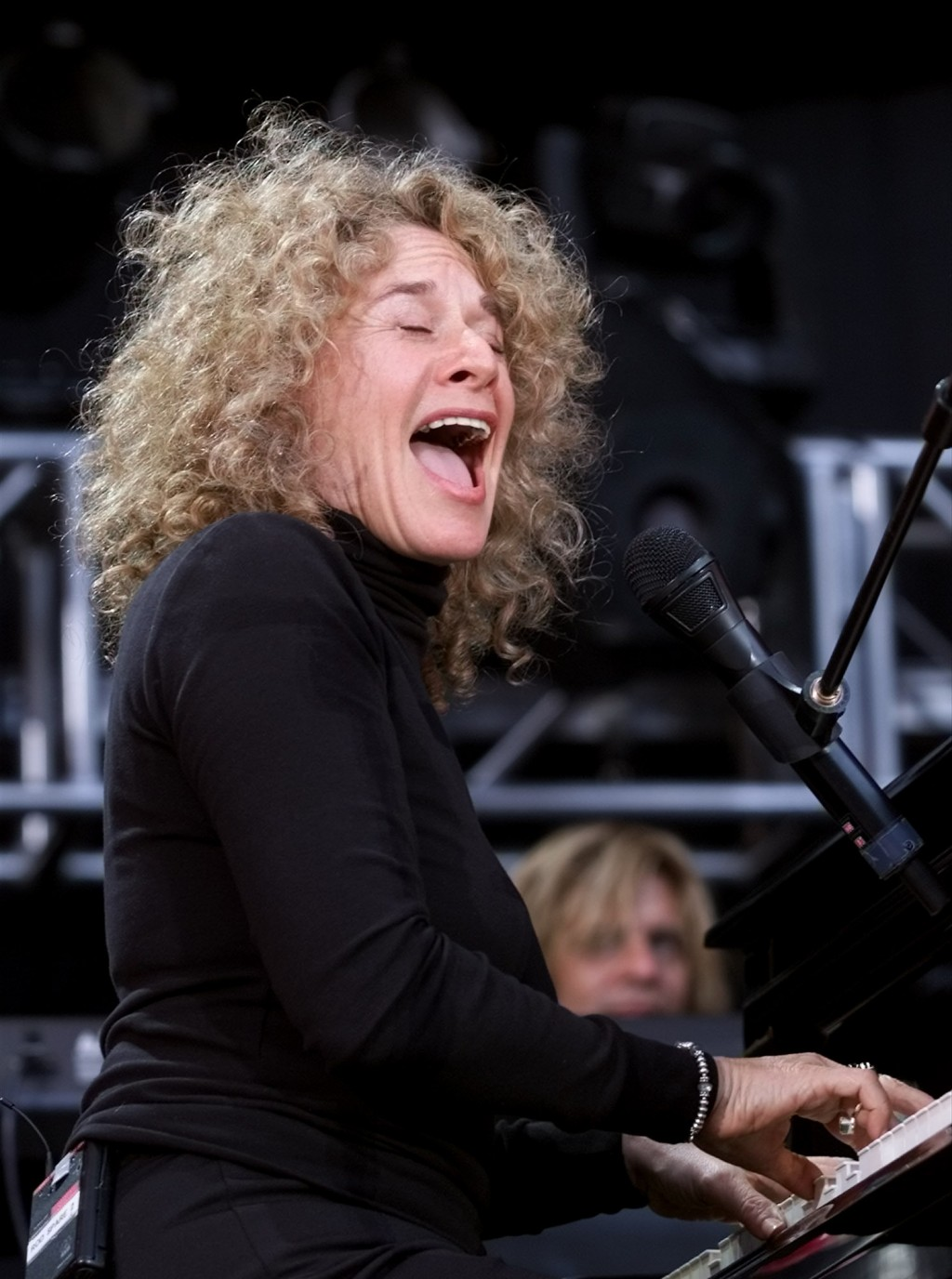 """FILE - Carole King performs during the """"United We Stand: What More Can I Give?"""" benefit concert in Washington on Oct. 21, 2001. King will be inducted ..."""