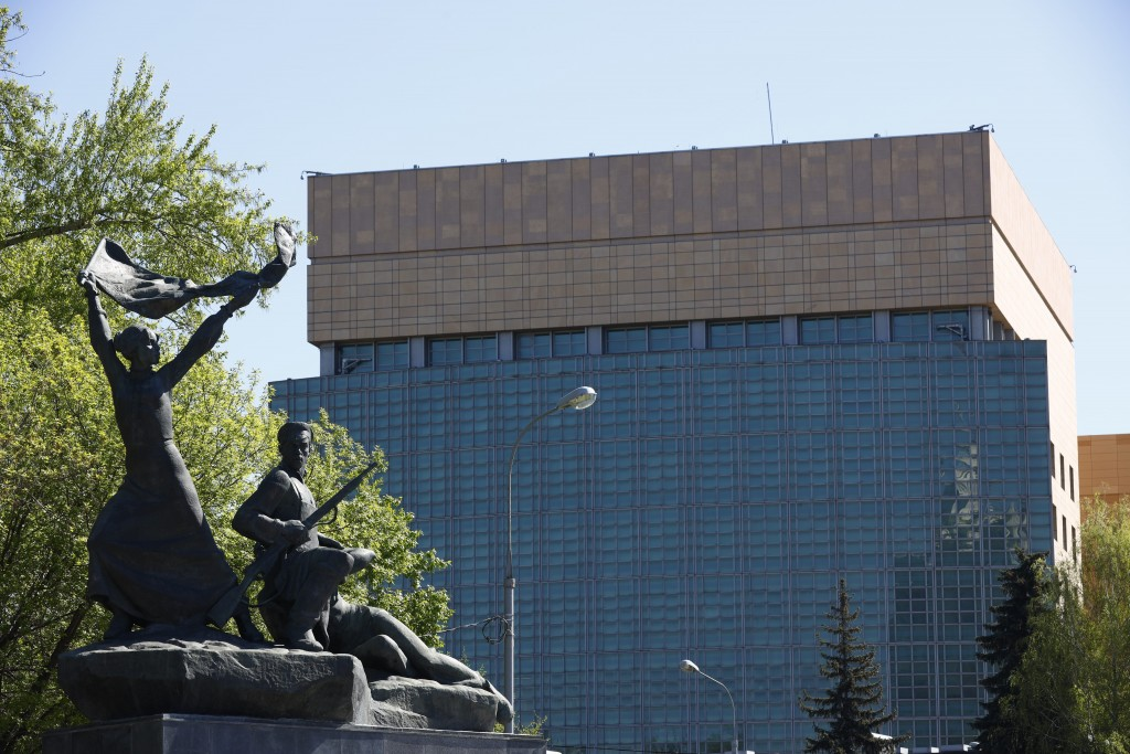 The U.S. Embassy is seen behind a monument to the Revolution workers of 1905 Revolution in Moscow, Russia, Tuesday, May 11, 2021. Under Kremlin orders...