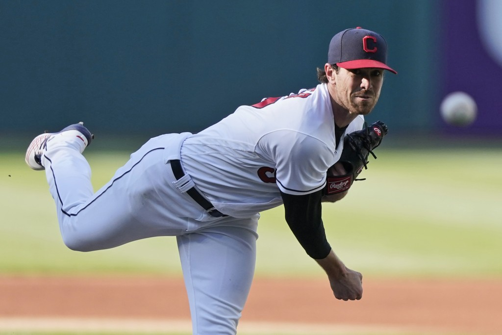 Cleveland Indians starting pitcher Shane Bieber delivers in the first inning of a baseball game against the Chicago Cubs, Tuesday, May 11, 2021, in Cl...
